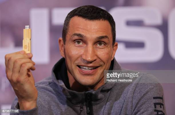 Wladamir Klitschko holds a USB stick containing his predictions for the fight during a press conference for his Super Heavyweight title fight against...