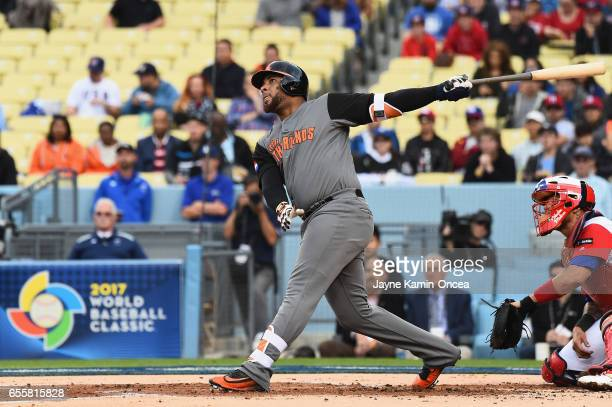 Wladimir Balentien of the Netherlands hits 2-run home run against team Puerto Rico in the first inning during Game 1 of the Championship Round of the...