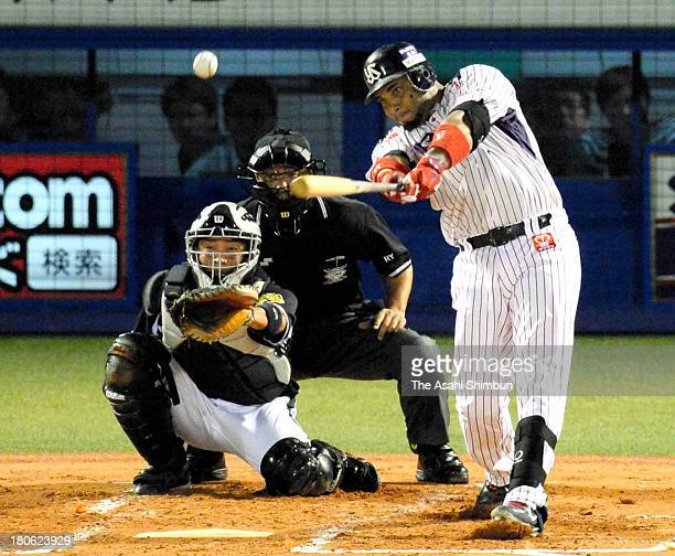 Wladimir Balentien of Yakult Swallows hits a tworun homer new record of 56th of the season in the bottom of first inning against Hanshin Tigers at...