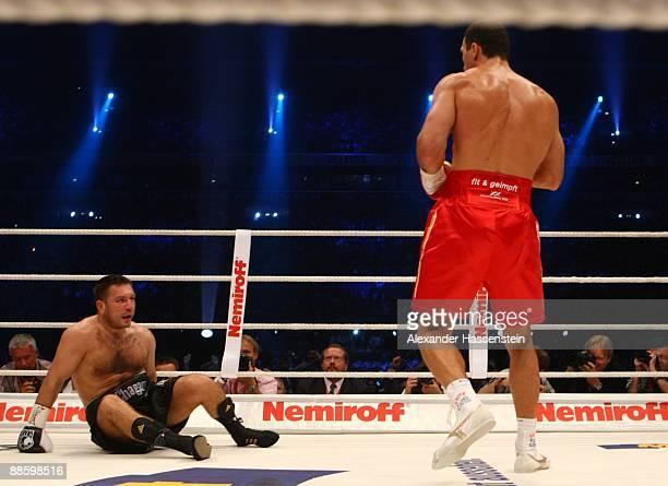 Wladimir Klischko of Ukraine knocks down Ruslan Chagaev of Uzbekistan during their WBO, IBF & IBO Heavyweight title fight at Veltins Arena on June...