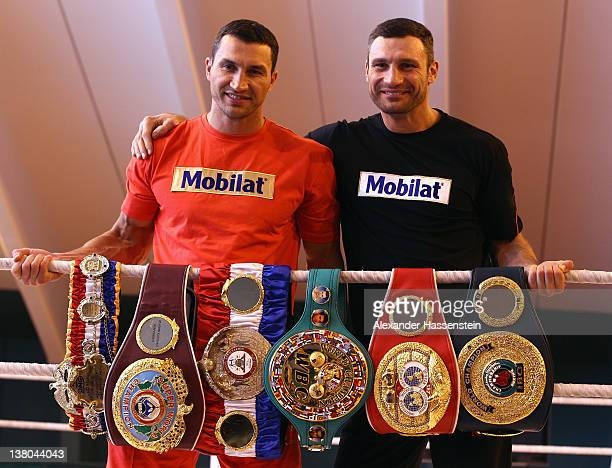 Wladimir Klitschko and his brother Vitali Klitschko pose with their championship belts including the 'THE RING' magazine belt WBO Super World...