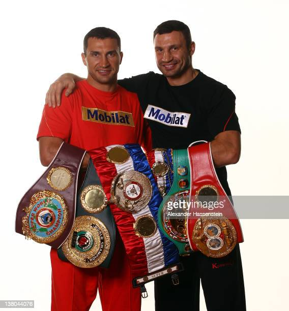 Wladimir Klitschko and his brother Vitali Klitschko pose with their championship belts including the WBO Super World Champion belt 'THE RING'...