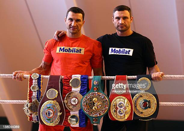 "Wladimir Klitschko and his brother Vitali Klitschko pose with their championship belts including the ""THE RING"" magazine belt , WBO Super World..."