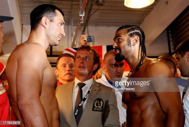 Wladimir Klitschko David Haye during the weigh in for their upcoming heavy weight title fight at Karstadt Sports shopping centre on July 1 2011 in...