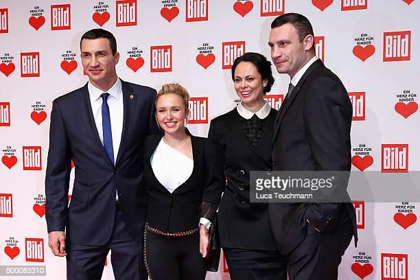 Wladimir Klitschko, Hayden Panettiere, Natalia Klitschko and Vitali Klitschko arrive for the Ein Herz Fuer Kinder Gala 2015 at Tempelhof Airport on...