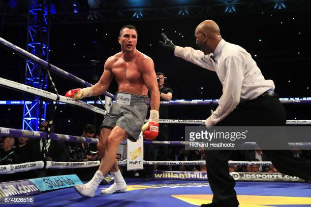 Wladimir Klitschko is given a count after being knocked down by Anthony Joshua in the IBF WBA and IBO Heavyweight World Title bout at Wembley Stadium...