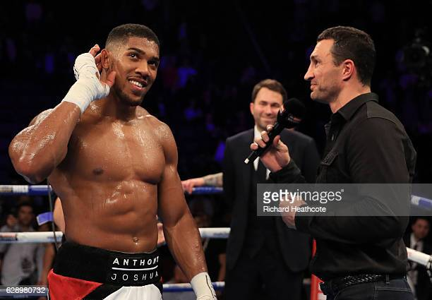 Wladimir Klitschko of Ukraine and Anthony Joshua of England react following the announcement that the pair will fight at Wembley Stadium in April...