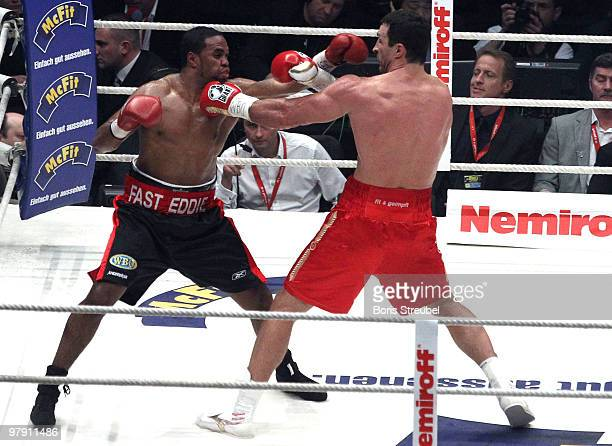 Wladimir Klitschko of Ukraine and Eddie Chambers of USA exchange punches during their IBF WBO and IBO Heavyweight World Championship fight between...