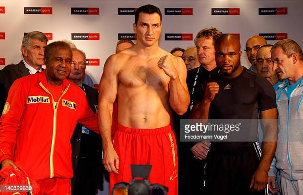 Wladimir Klitschko of Ukraine and JeanMarc Mormeck of France pose during the weigh in for their IBO WBO WBA and IBF heavy weight title fight at the...
