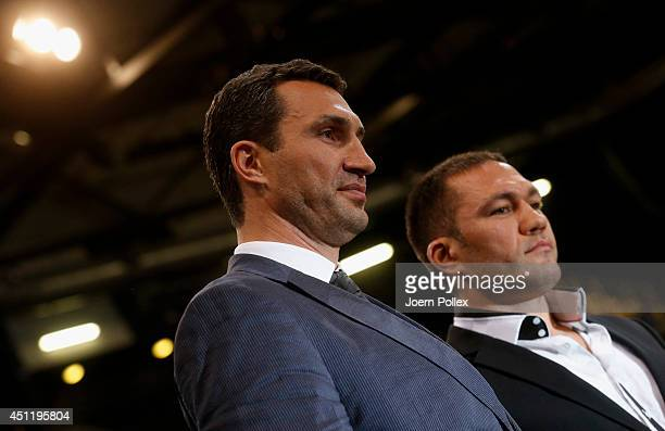 Wladimir Klitschko of Ukraine and Kubrat Pulev of Bulgaria pose during a press conference ahead of the upcoming heavyweight boxing title fight...
