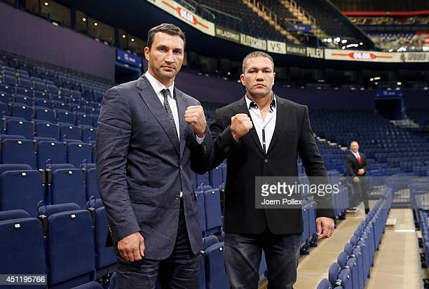 Wladimir Klitschko of Ukraine and Kubrat Pulev of Bulgaria pose after a press conference ahead of the upcoming heavyweight boxing title fight between...