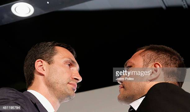 Wladimir Klitschko of Ukraine and Kubrat Pulev of Bulgaria pose head to head after a press conference ahead of the upcoming heavyweight boxing title...