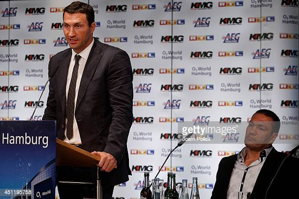 Wladimir Klitschko of Ukraine and Kubrat Pulev of Bulgaria talk to each other during a press conference ahead of the upcoming heavyweight boxing...