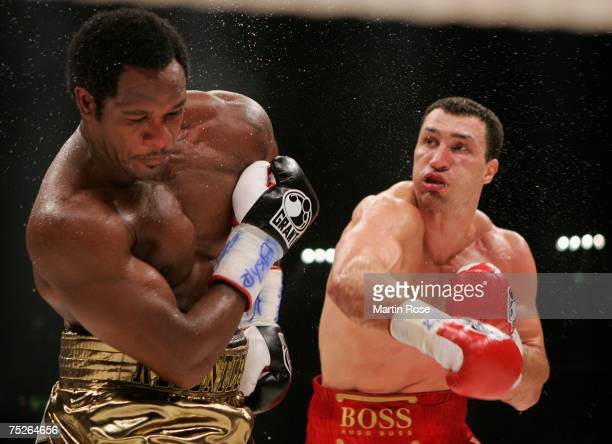 Wladimir Klitschko of Ukraine and Lamon Brewster of USA in action during the IBO and IBF World Heavyweight Championship fight at the Koeln Arena on...