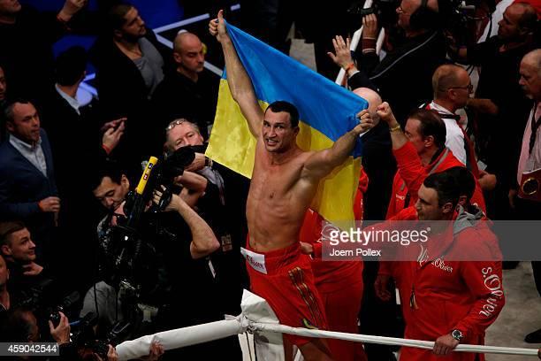 Wladimir Klitschko of Ukraine celebrates after winning the IBF WBA WBO and IBO World Championship fight between Wladimir Klitschko and his challenger...