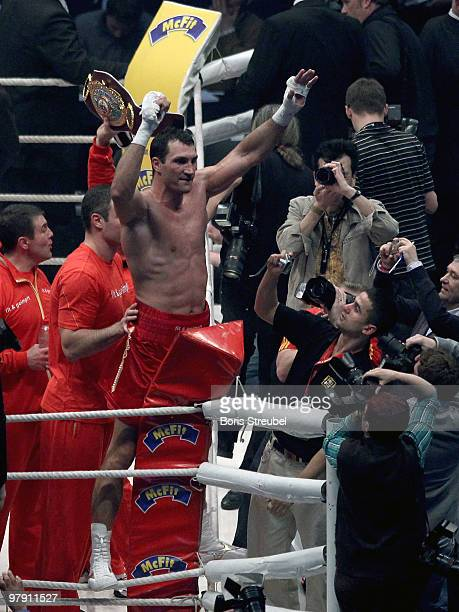 Wladimir Klitschko of Ukraine celebrates after winning the IBF WBO and IBO Heavyweight World Championship fight against Eddie Chambers of USA at the...