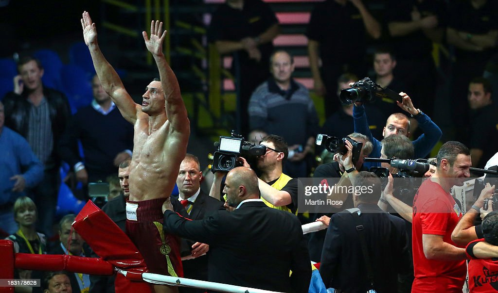Wladimir Klitschko of Ukraine celebrates after winning the WBO, WBA, IBF and IBO heavy weight title fight between Wladimir Klitschko and Alexander Povetkin of Russia at Olimpiyskiy Arena on October 5, 2013 in Moscow, Russia.
