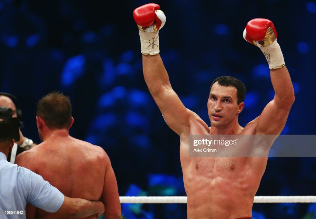 Wladimir Klitschko of Ukraine celebrates defeating Francesco Pianeta of Italy and retaining his IBF, IBO, WBA, WBO titles after their World Championship fight at SAP Arena on May 4, 2013 in Mannheim, Germany.