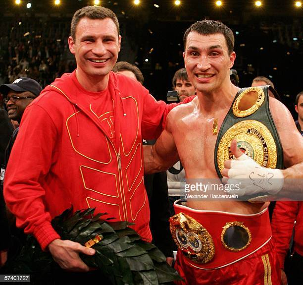 Wladimir Klitschko of Ukraine celebrates winning with his brother Vitali Klitschko after defeating Chris Byrd of the USA in their IBF and vacant IBO...