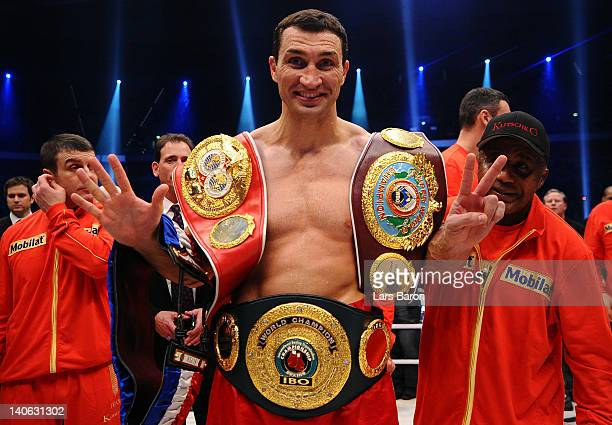 Wladimir Klitschko of Ukraine celebrates with the belts after winning his WBO, WBA, IBF and IBO heavy weight titel fight against Jean Marc Mormeck at...