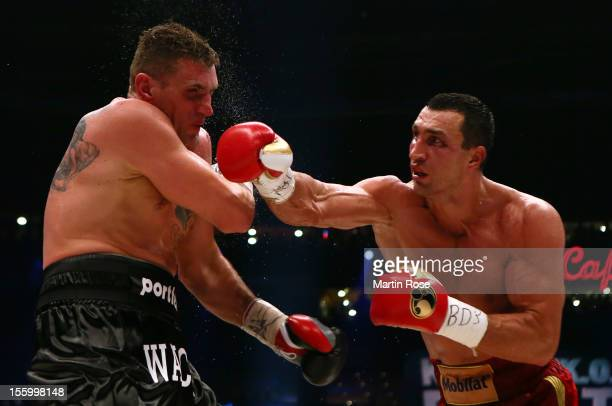 Wladimir Klitschko of Ukraine exchange punches with Mariusz Wach of Poland during the WBA-, IBF,- WBO- and IBO-heavy weight title fight between...