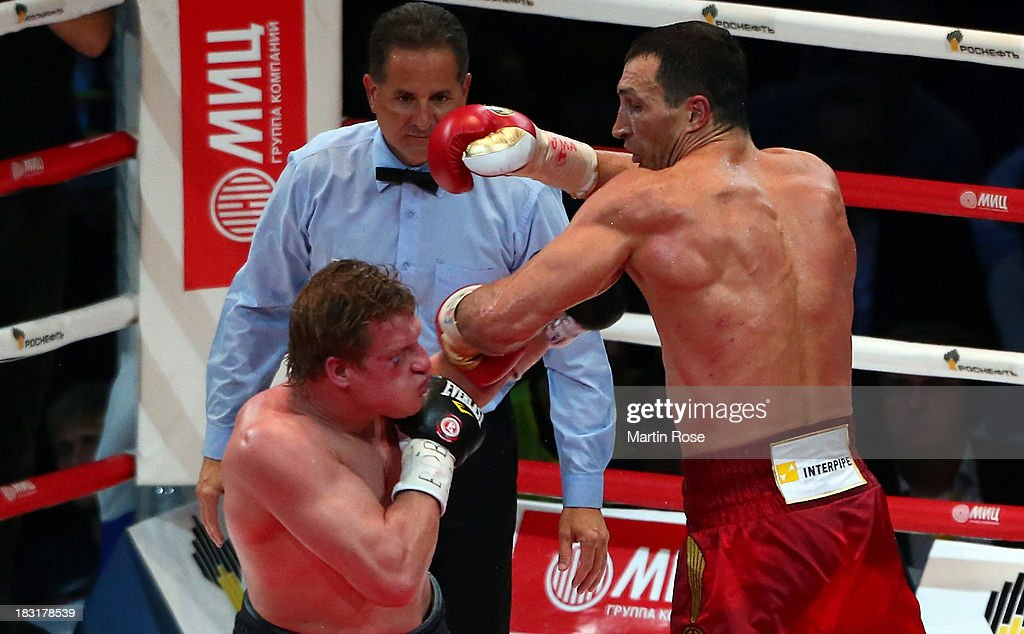 Wladimir Klitschko (R) of Ukraine exchanges punches with Alexander Povetkin (L) of Russia during their WBO, WBA, IBF and IBO heavy weight title fight between Wladimir Klitschko and Alexander Povetkin of Russia at Olimpiyskiy Arena on October 5, 2013 in Moscow, Russia.