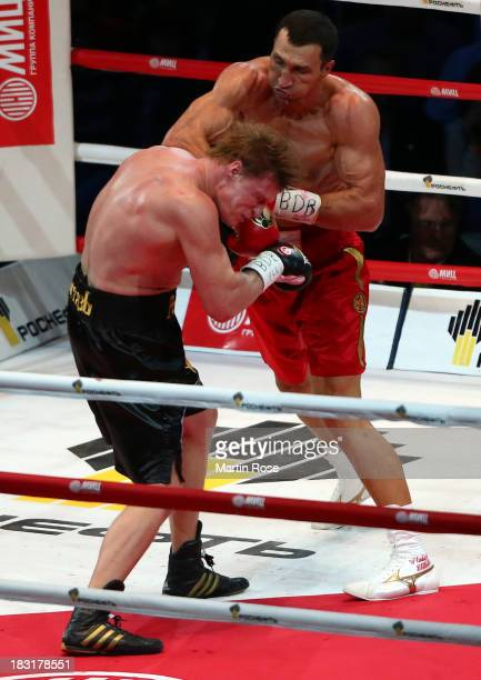 Wladimir Klitschko of Ukraine exchanges punches with Alexander Povetkin of Russia during their WBO, WBA, IBF and IBO heavy weight title fight between...