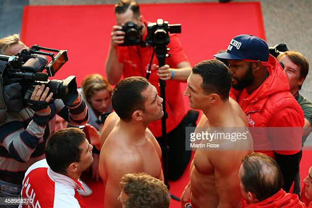 Wladimir Klitschko of Ukraine faces Kubrat Pulev of Bulgaria during the official weigh in session ahead of the IBF WBA WBO and IBO World Championship...