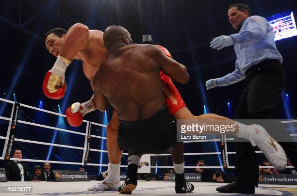 Wladimir Klitschko of Ukraine falls over Jean Marc Mormeck of France during their WBO WBA IBF and IBO heavy weight titel fight at Esprit Arena on...