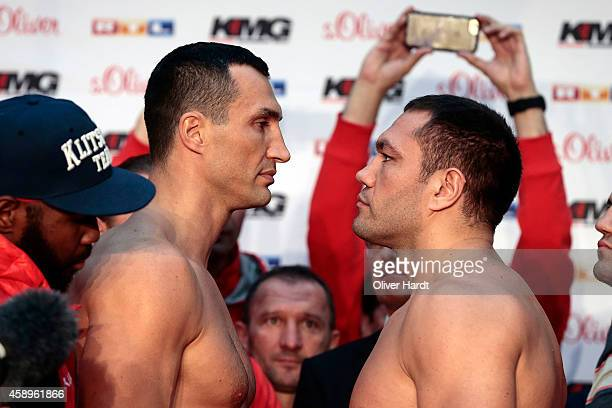 Wladimir Klitschko of Ukraine head to head with Kubrat Pulev of Bulgaria during the official weigh in session ahead of the IBF WBA WBO and IBO World...