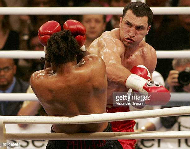 Wladimir Klitschko of Ukraine hits Chris Byrd of the USA during their IBF and vacant IBO World Heavyweight Championship fight at the SAP Arena on...