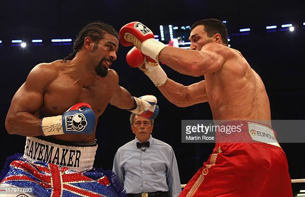 Wladimir Klitschko of Ukraine hits out at David Haye of England during their World Heavyweight unification fight at the Imtech Arena on July 2 2011...