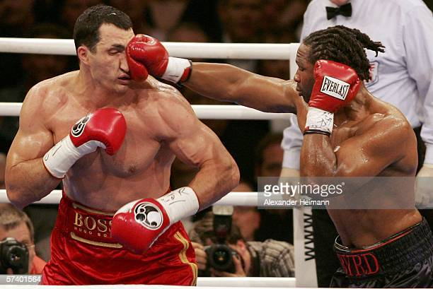 Wladimir Klitschko of Ukraine is hit by Chris Byrd of the USA during their IBF and vacant IBO World Heavyweight Championship fight at the SAP Arena...