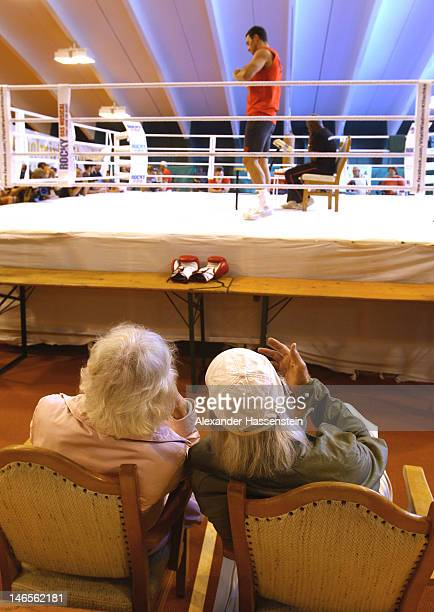 Wladimir Klitschko of Ukraine is watched by two elderly people while preparing for a training session at Hotel Stanglwirt on June 19 2012 in Going...