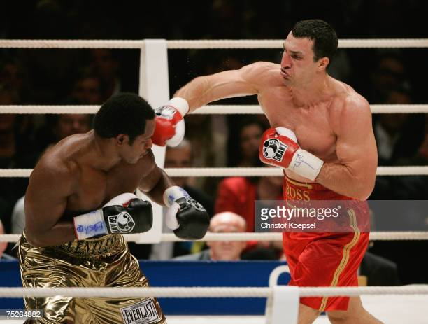 Wladimir Klitschko of Ukraine knocks back Lamon Brewster of the USA in action during the IBO and IBF World Heavyweight Championship fight at the...