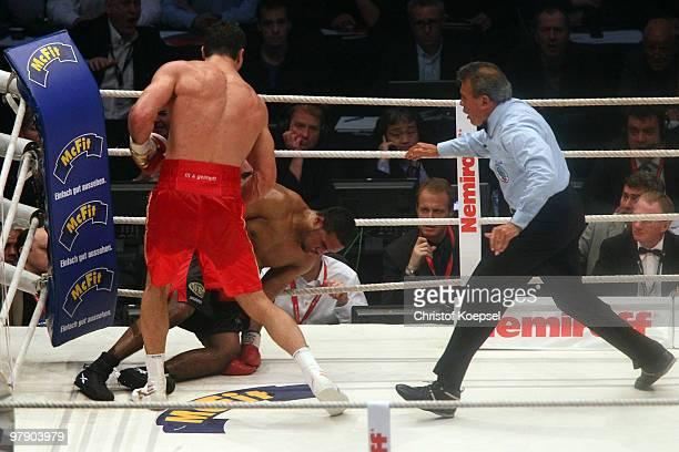 Wladimir Klitschko of Ukraine knocks down Eddie Chambers of USA during their WBO Heavyweight World Championship fight in the twelfth round at the...
