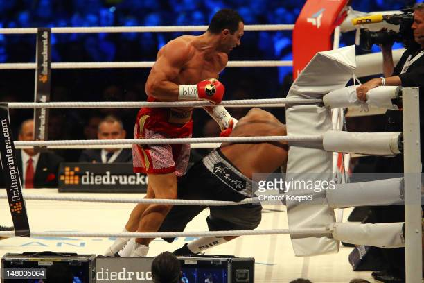 Wladimir Klitschko of Ukraine knocks down Tony Thompson of USA in the sixth round during the WBA-, IBF,- WBO- and IBO-heavy weight title fight...
