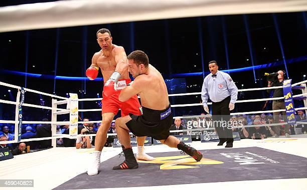 Wladimir Klitschko of Ukraine knocks Kubrat Pulev of Bulgaria down during their IBF heavy weight title fight between Wladimir Klitschkoat and Kubrat...