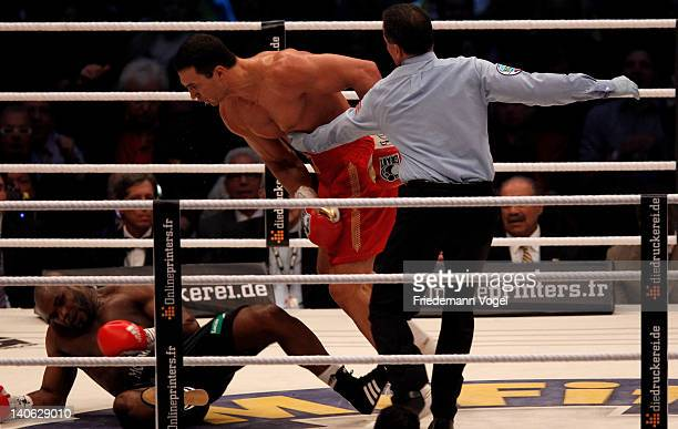 Wladimir Klitschko of Ukraine knocks out Jean Marc Mormeck of France during their WBO WBA IBF and IBO heavy weight title fight at Esprit Arena on...