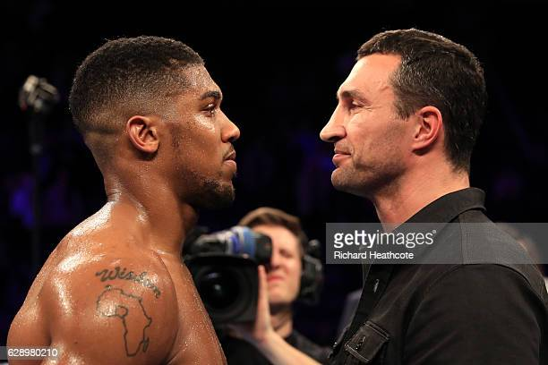Wladimir Klitschko of Ukraine looks at Anthony Joshua of England following the announcement that the pair will fight at Wembley Stadium in April 2017...