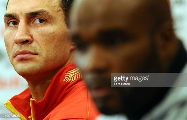 Wladimir Klitschko of Ukraine looks on next to JeanMarc Mormeck of France during a press conference at Intercontinental Hotel on February 27 2012 in...