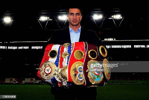 Wladimir Klitschko of Ukraine pose with his championship belts after a press conference at EspritArena on October 12 2011 in Duesseldorf Germany The...