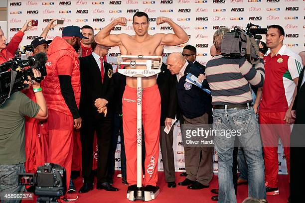 Wladimir Klitschko of Ukraine poses during the official weigh in session ahead of the IBF WBA WBO and IBO World Championship fight between Wladimir...