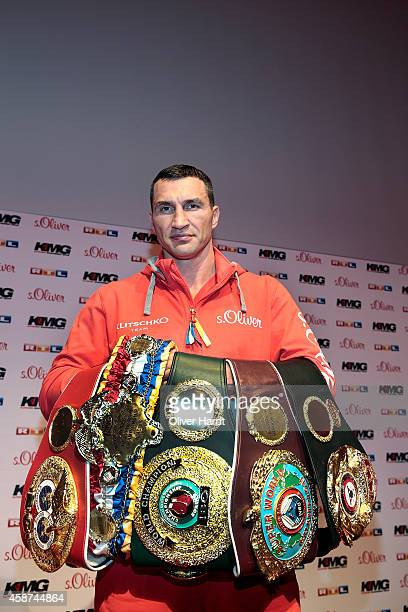 Wladimir Klitschko of Ukraine poses with the title belts on during a press conference ahead of the upcoming heavyweight boxing title fight between...