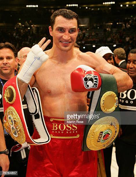 Wladimir Klitschko of Ukraine poses with the trophy after the IBO and IBF World Heavyweight Championship fight at the Koeln Arena on July 7 2007 in...