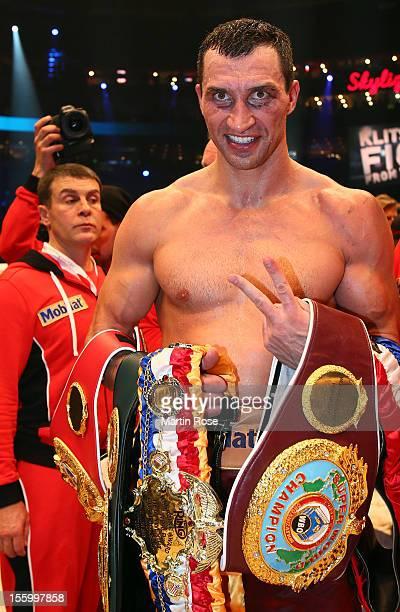 Wladimir Klitschko of Ukraine poses with the trophy after winning the WBA-, IBF,- WBO- and IBO-heavy weight title fight between Wladimir Klitschko of...