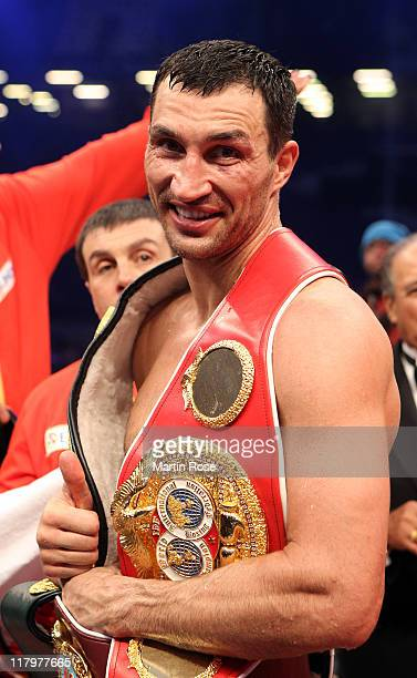 Wladimir Klitschko of Ukraine poseswith the trophy after the World Heavyweight unification fight at the Imtech Arena on July 2 2011 in Hamburg Germany