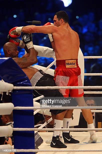 Wladimir Klitschko of Ukraine punch Tony Thompson of USA during the WBA-, IBF,- WBO- and IBO-heavy weight title fight between Wladimir Klitschko of...