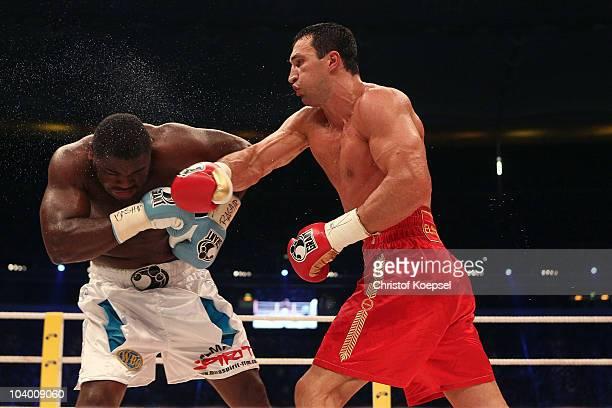 Wladimir Klitschko of Ukraine punches Samuel Peter of Nigeria during the WBO and IBF World Championship Heavyweight fight between Wladimir Klitschko...
