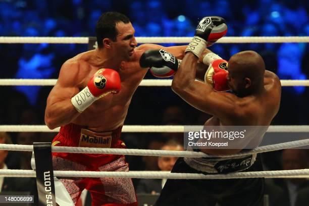 Wladimir Klitschko of Ukraine punches Tony Thompson of USA during the WBA-, IBF,- WBO- and IBO-heavy weight title fight between Wladimir Klitschko of...